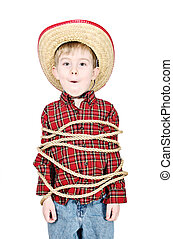 a young boy dressed up in a cowboy costume is tied up with rope