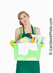 Tied young maid carrying cleaning supplies