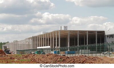 Tiemlapse of building new large warehouse
