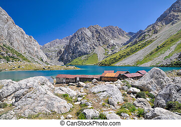 Tien-Shan lake - Mountain huts by crystal clear lake in ...