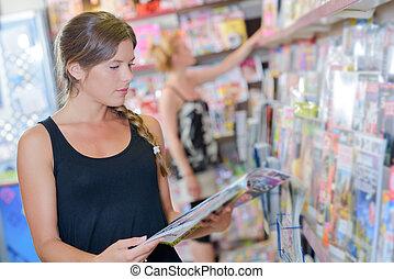 tienda, lectura de mujer
