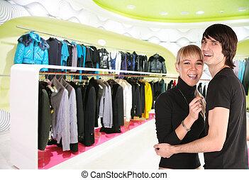 tienda, pareja, joven, ropa