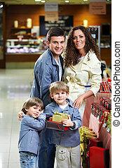tienda, sonriente, familia
