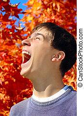 tiener, rejoices, herfsten
