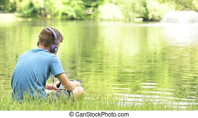 tienerjongen, op, lakeside