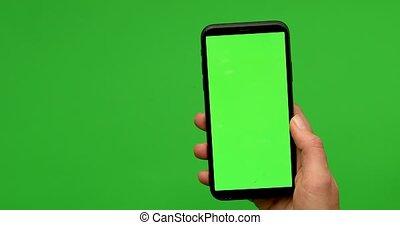 tient, greeen, main, écran, smartphone, femme