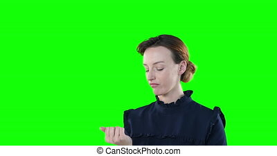 Tiered Caucasian woman on green background - Attractive ...