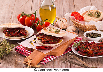 Tigella bread with sun-dried tomatoes.