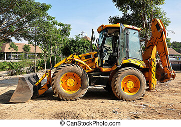 Front end loader dropping scrap materials truck  Hydraulic