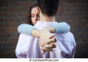 Tight embrace - Conceptual image of female hands while...