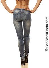 tight jeans - pretty woman's legs and buttocks in tight...