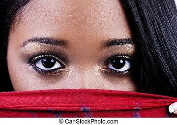 Tight Shot Of Attractive African American Woman Eyes Over Red Shirt