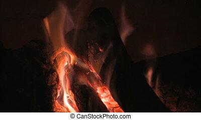 tight shot of wood burning slow motion