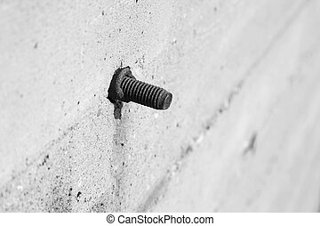 tighten bolts rust on concrete walls