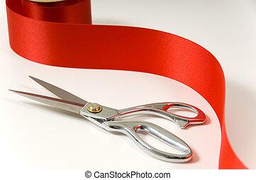 tijeras, cinta roja