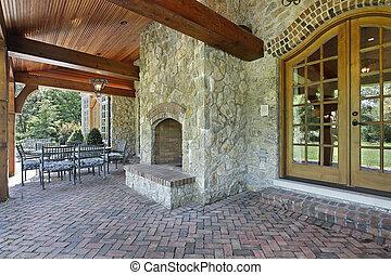 tijolo, pátio, com, pedra, lareira