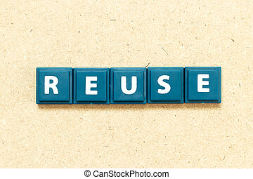 Tile alphabet letter in word reuse on wood background