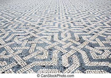 Tile brick floor in Lisbon Town Square, Portugal