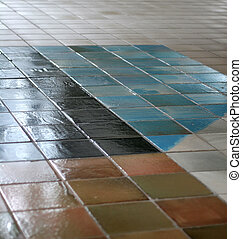 Ceramic tile floor with interesting pattern fading into the distance