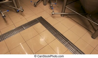 Tile floor in brewery. Top view tile floor in beer plant.