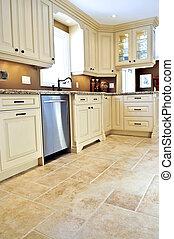 Tile floor in modern kitchen - Ceramic tile floor in a...