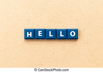 Tile letter in word hello on wood background