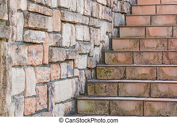 Tile stairs with stone brick wall.