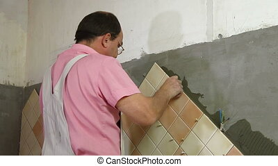 Tile Worker Wipes Grout