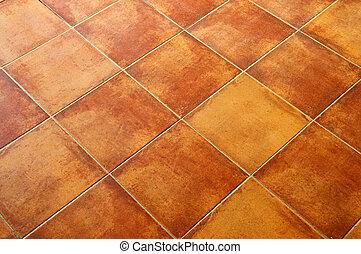 Closeup of square terracotta ceramic tile floor background