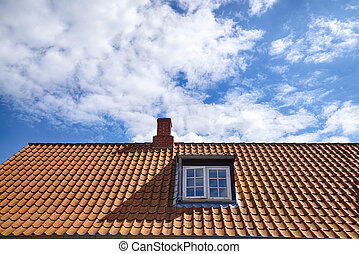 Tiled red roof with a rooftop window