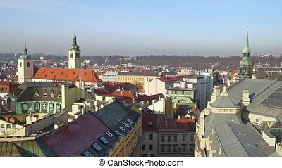 Tiled roofs and gothic spires of old town of Prague on a...