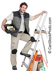 Tiler about to climb ladder