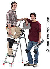 Tiler and apprentice on white background