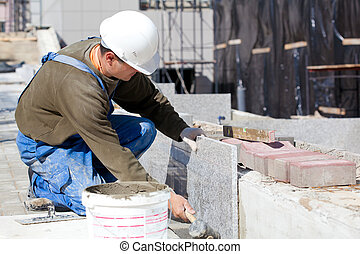Tiler at work