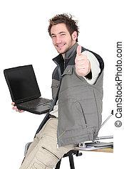 Tiler with a laptop