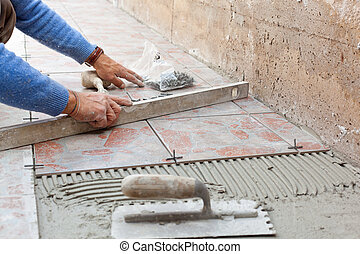 Tiler works with flooring in the backyard.