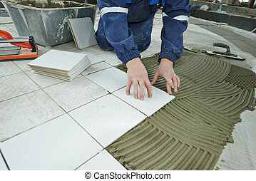tilers at industrial floor tiling renovation - industrial...