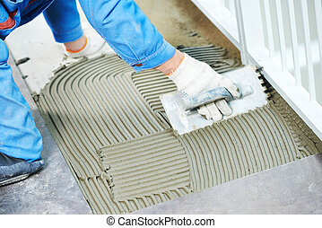 tilers at industrial floor tiling renovation - industrial...