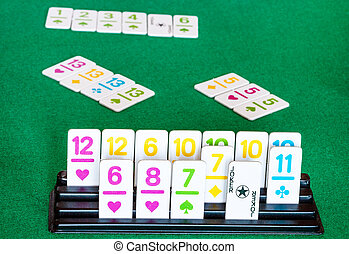 tiles in rack and board during playing in Rummy tile-based ...
