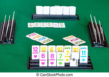 tiles in rack and gameplay in Rummy on table - tiles in rack...