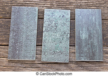 Tiles on wooden background