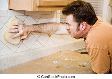 Tilesetter Wipes Down Tile - Tilesetter wiping grout off of ...
