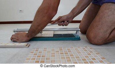 tiling tool, cutting tiles close up