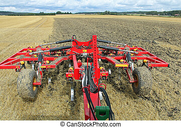 Tilling a Field As Seen from Tractor - Tilling a stubble ...