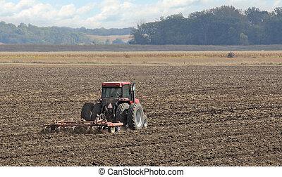 Tilling Farm Field - Tractortilling the soil in a farm field...