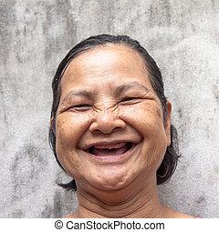 tillsluta, stående, av, bruten, tand, thai, kvinna, skratta