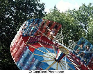 tilt-a-whirl in an amusement park