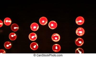 Tilt move 2012 - crane shot of 2012 made of candles. Tilt...