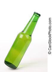 tilt of beer bottle - a bottle of beer is slanted with white...