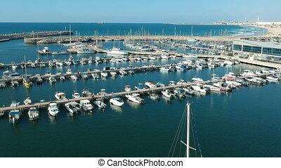Tilt Reveal shot of boats docking at the Ashdod Marina shot...